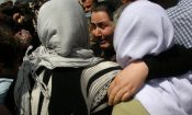 Yazidi Women released by Islamic State group militants, hug as they arrive in Kirkuk, 180 miles (290 kilometers) north of Baghdad, Iraq, Wednesday, April 8, 2015. The Islamic State group released more than 200 Yazidis on Wednesday after holding them for eight months, an Iraqi Kurdish security official said, the latest mass release of captives by the extremists. (AP Photo)