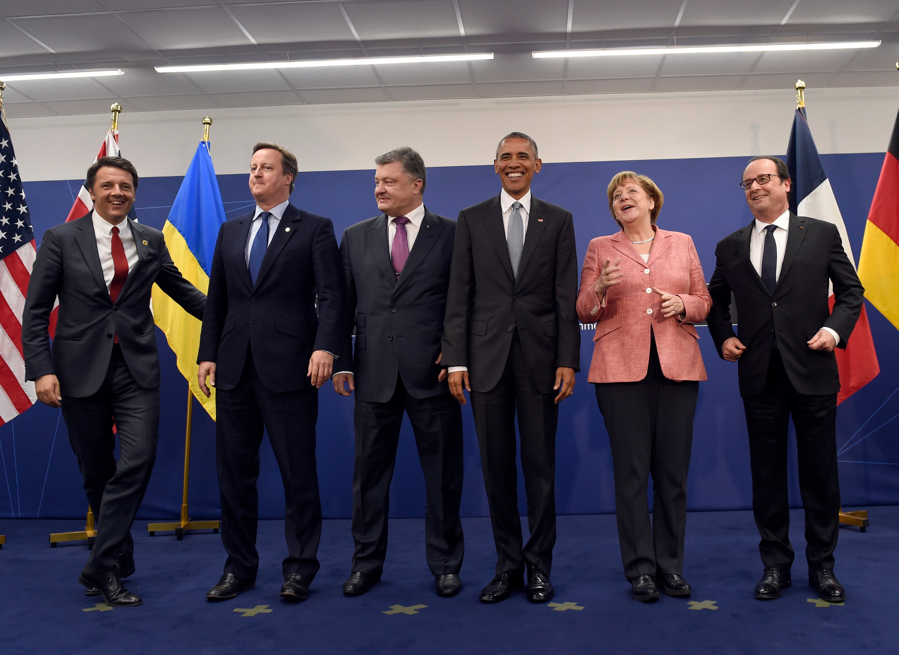 President Barack Obama poses for a photo with, from left, Italian Prime Minister Matteo Renzi, British Prime Minister David Cameron, Ukrainian President Petro Poroshenko, German Chancellor Angela Merkel, and French President Francois Hollande, at PGE National Stadium in Warsaw, Poland, Saturday, July 9, 2016. (AP Photo/Susan Walsh)