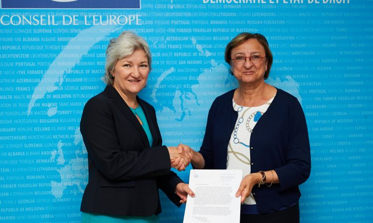 U.S. Deputy Permanent Observer to the Council of Europe Amy Westling handing over the letter of agreement offering the funds to COE Deputy Secretary General Gabriella Battaini-Dragoni.