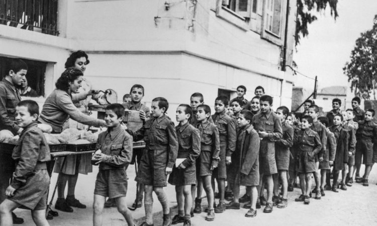 Children in Greece line up for bread made from flour distributed under the Marshall Plan. (© Bettmann/Getty Images)