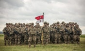 U.S. soldiers stand in formation with troops from Poland, the United Kingdom, Romania, Lithuania and Canada for a ceremony opening a training exercise in Poland. (U.S. Army/Staff Sergeant Brian Kohl)
